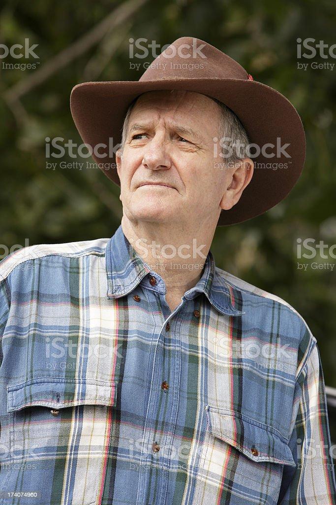 Worried farmer wearing bush hat stock photo