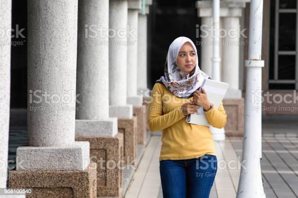 Worried female asian muslim college clutching her notebook picture id958100540?b=1&k=6&m=958100540&s=612x612&h=cz tinvbo2ur2p1m u1nuqg2kdjrjmkejt7uqpbkefu=