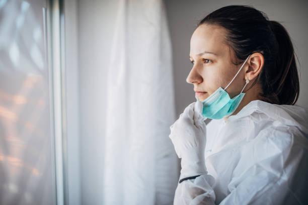Worried female doctor looking through the hospital window picture id1212922973?b=1&k=6&m=1212922973&s=612x612&w=0&h=41p jcgkkd x27lzo2ni5 6baufaecbopfu0imfboxq=