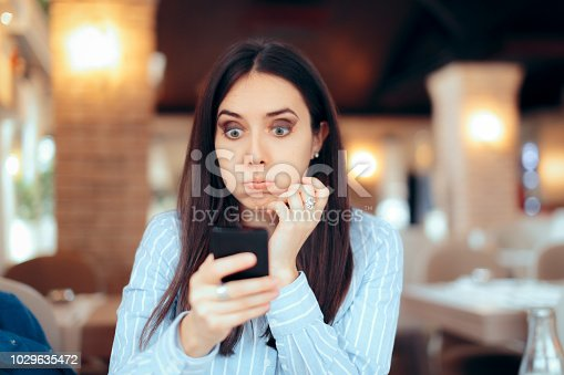 istock Worried Girl Reading Urgent SMS Text on Smartphone 1029635472