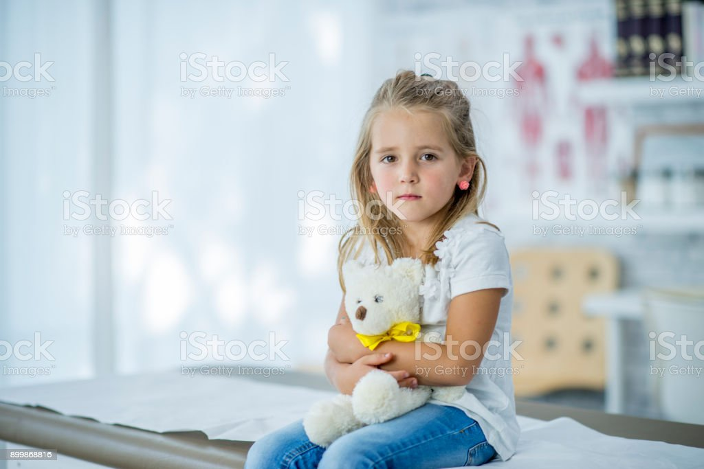 Worried Girl With Teddy Bear stock photo