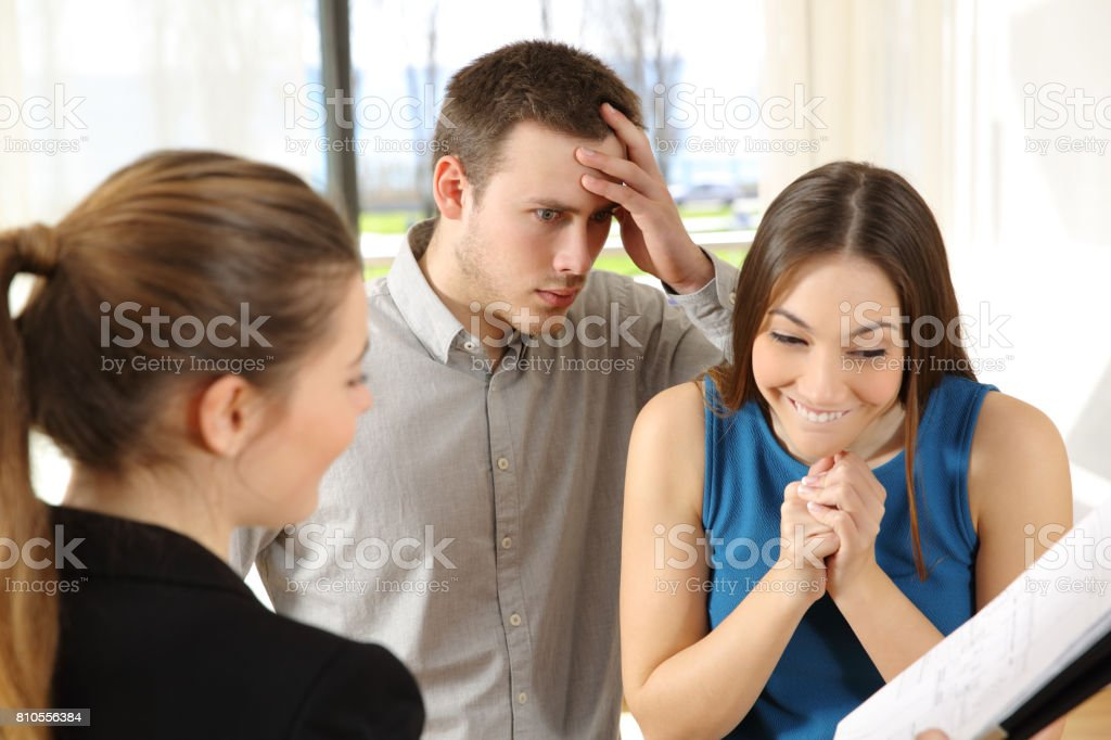 Worried husband with expensive new house stock photo