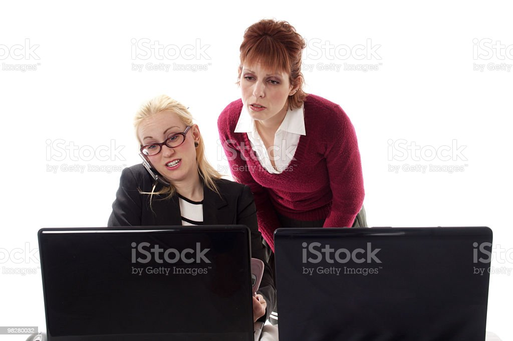 Worried It workers look at computer screen. royalty-free stock photo