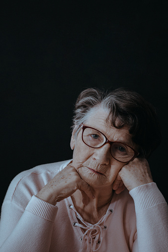 874789168 istock photo Worried lonely elderly woman 873930444