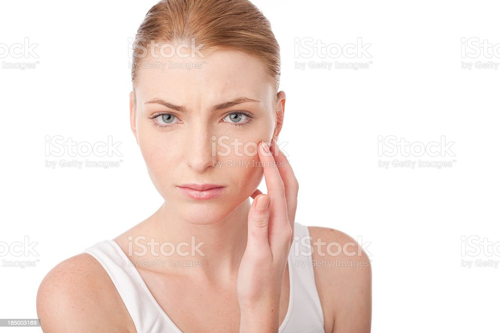 Worried looking woman on white background royalty-free stock photo