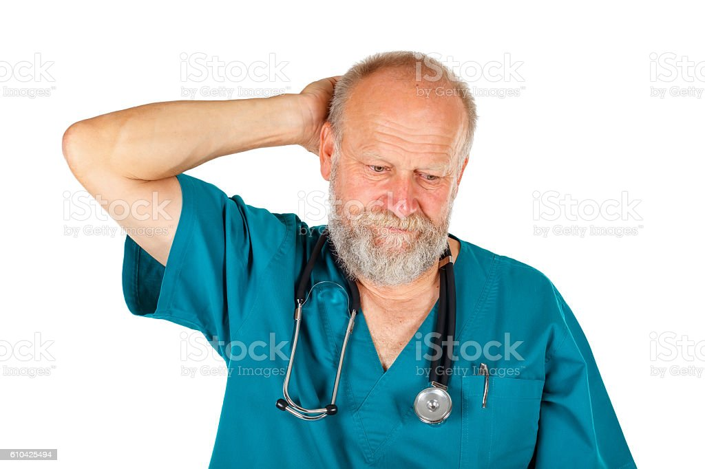 Worried male doctor stock photo