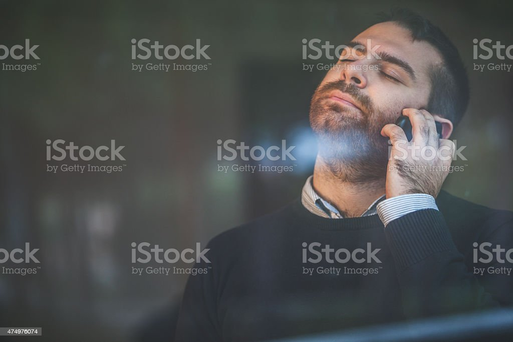 Worried man at the telephone: bad news stock photo