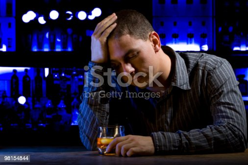 Worried Man Sitting At Bar With Whiskey Glass Dark Scene Stock Photo & More Pictures of Addiction