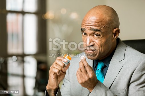 istock Worried man with an Opiod Prescription Pill 926369144