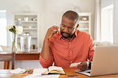 istock Worried man with bills call the bank 1152602555