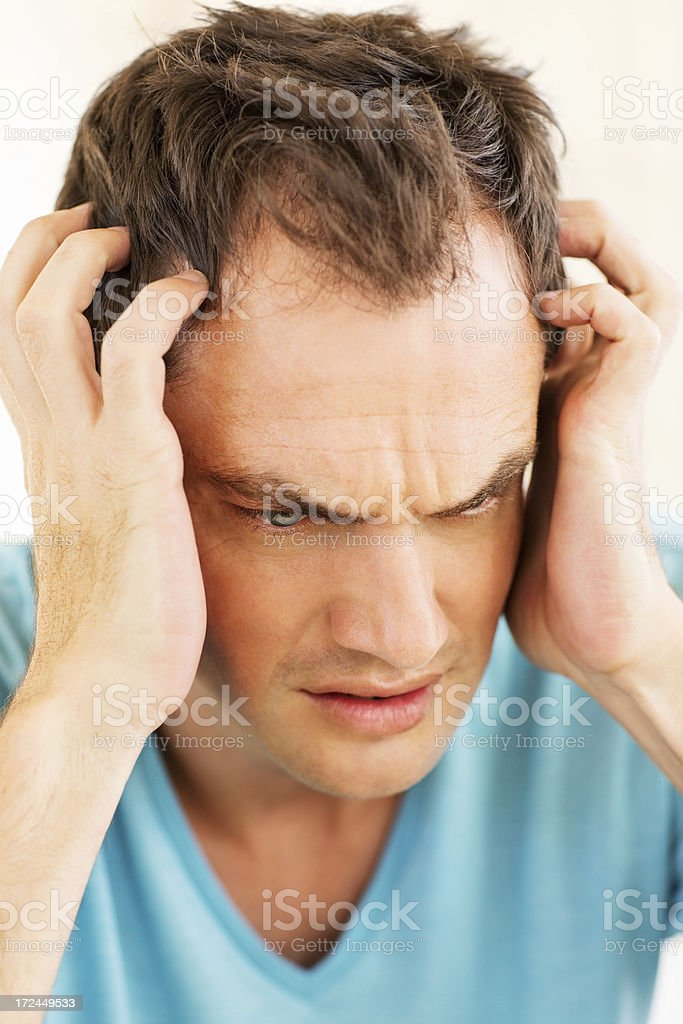 Worried Man With Head In Hands royalty-free stock photo