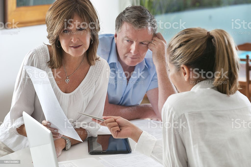 Worried mature Couple in Meeting With Advisor stock photo