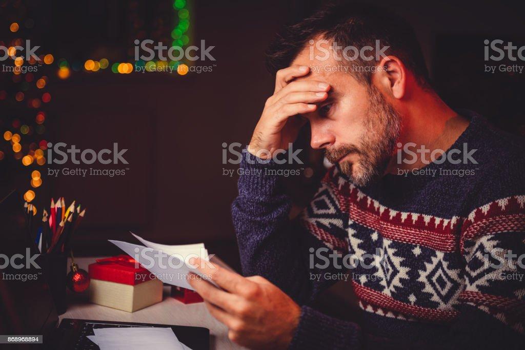Worried Men cheeking his mail late night stock photo