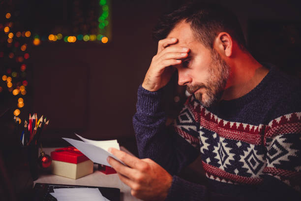 worried men cheeking his mail late night - emergency response stock pictures, royalty-free photos & images
