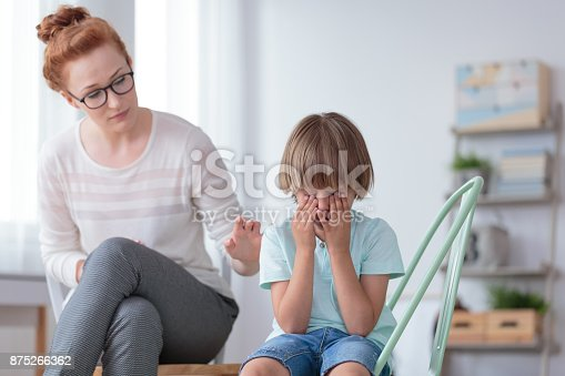 istock Worried mother comforting crying son 875266362
