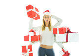 Worried young woman wearing christmas hat and holding white and red presents.http://www.mediafire.com/convkey/9394/c43m88czxmmliiyfg.jpg
