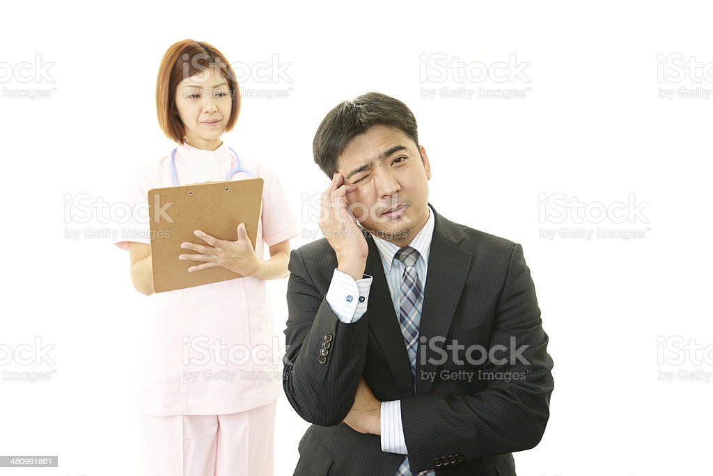 Worried nurse with patient stock photo