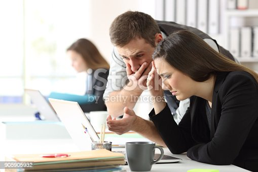 istock Worried office workers checking online content 905905932