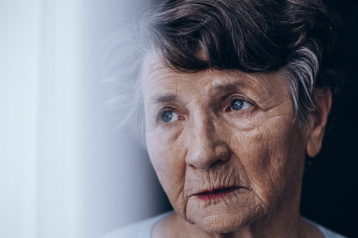 874789168 istock photo Worried old woman's face 873931326