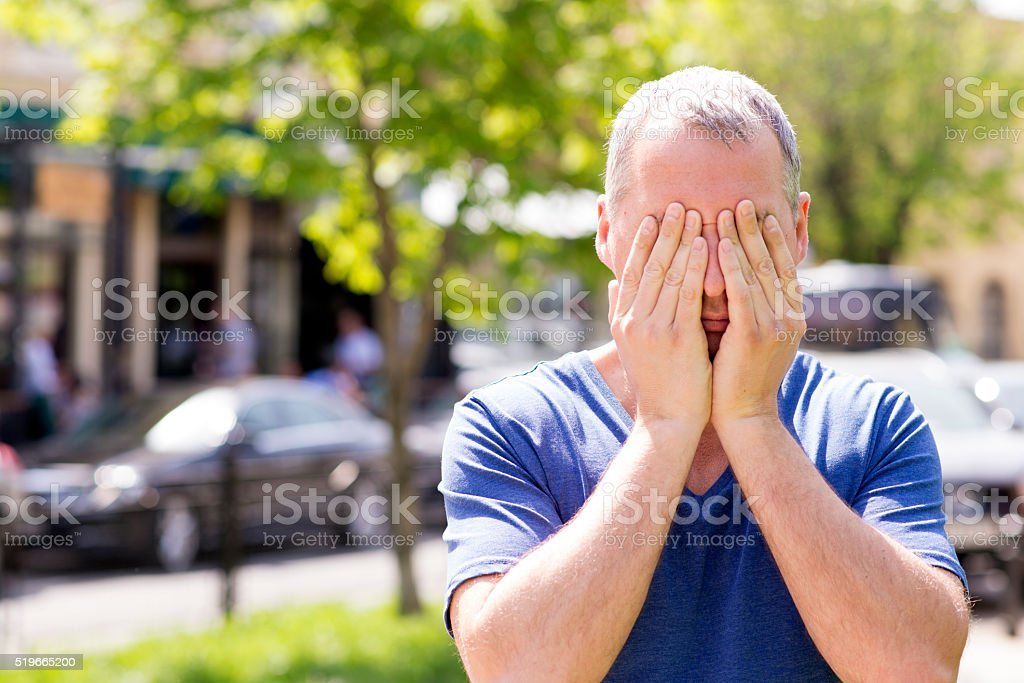 Worried or embarrassed man stock photo