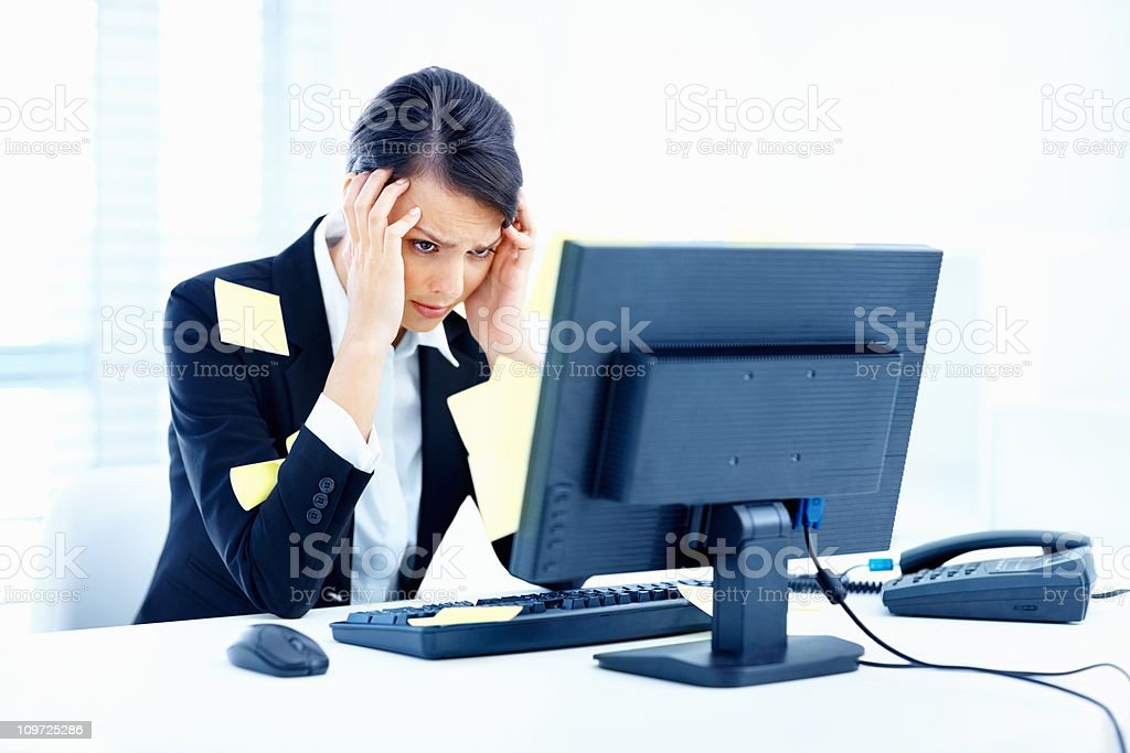 Worried overworked business woman with sticky reminder notes royalty-free stock photo