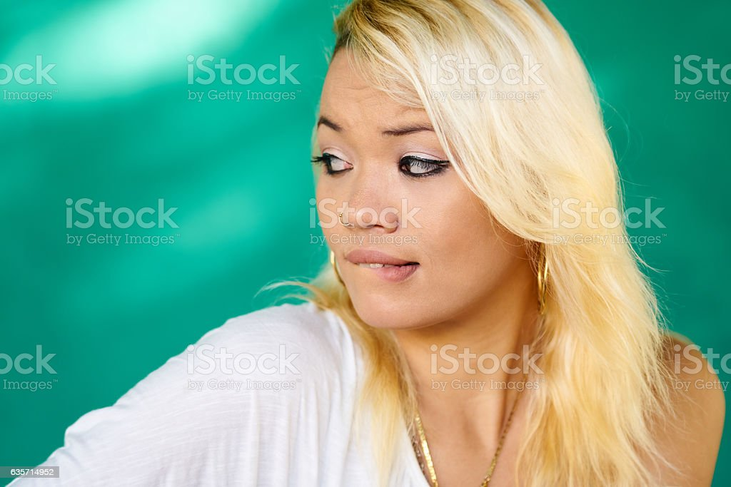 Worried People Portrait Latina Girl Biting Lips royalty-free stock photo