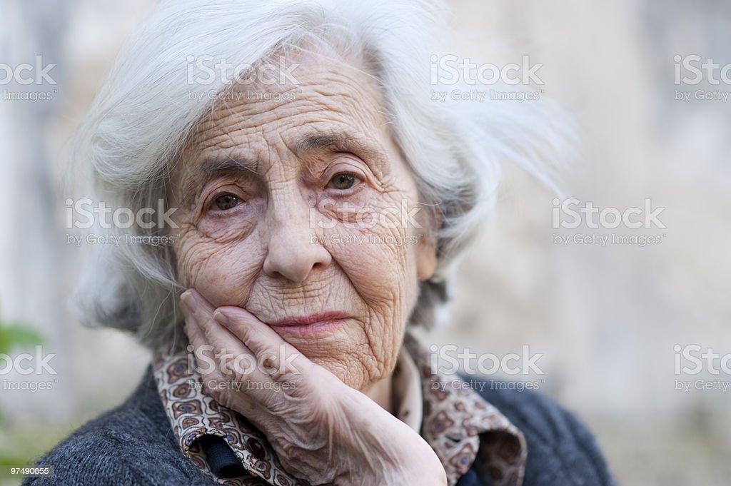 worried (senior woman) royalty-free stock photo