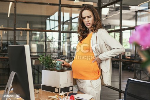istock Worried pregnant CEO finishing deals 985684216