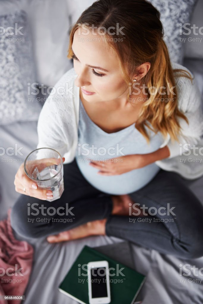 Worried pregnant woman drinking water royalty-free stock photo