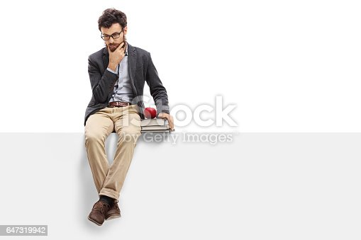 istock Worried professor sitting on a panel 647319942