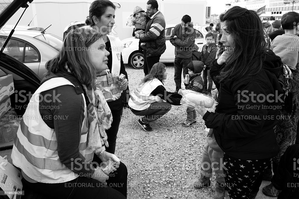 Worried refugee mother in food line in Chios refugee camp stock photo