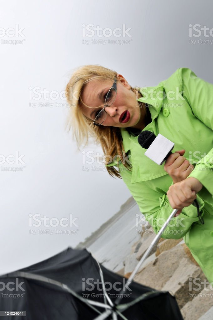 Worried Reporter Weathering the Storm stock photo