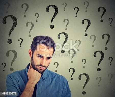 istock Worried sad man has many questions looking down 494730678