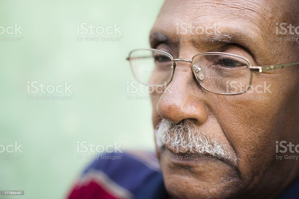 Worried senior african american man with eyeglasses Senior people and feelings, portrait of sad old black man with glasses and mustache. Copy space 70-79 Years Stock Photo