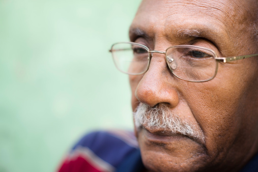 Worried Senior African American Man With Eyeglasses Stock Photo - Download Image Now
