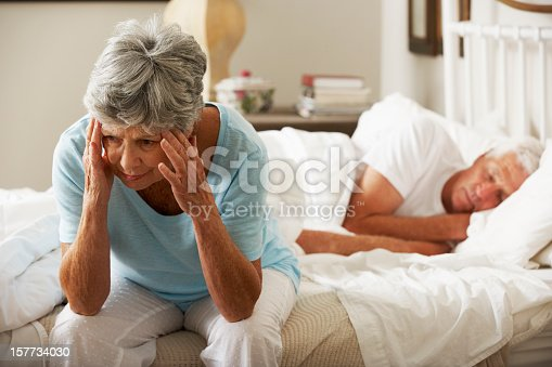 istock Worried Senior Woman Sits On Bed 157734030