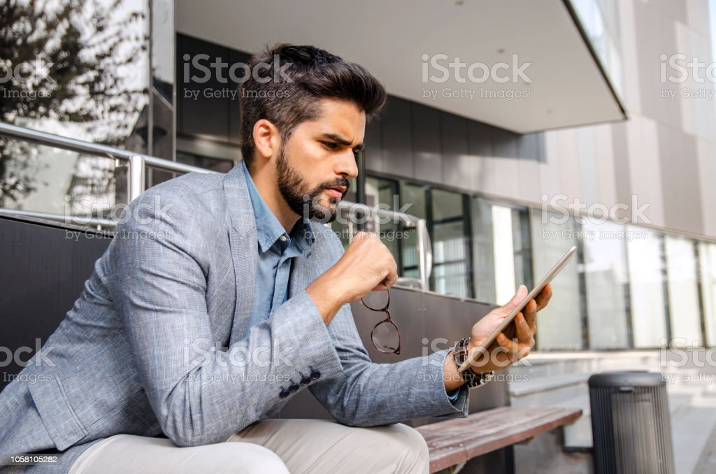 Worried, serious, handsome man in front  of the office - Royalty-free Adult Stock Photo