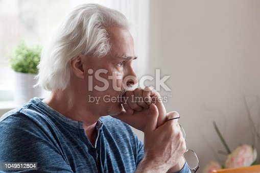 1162960006istockphoto Worried serious senior man looking away feeling anxious about problems 1049512804