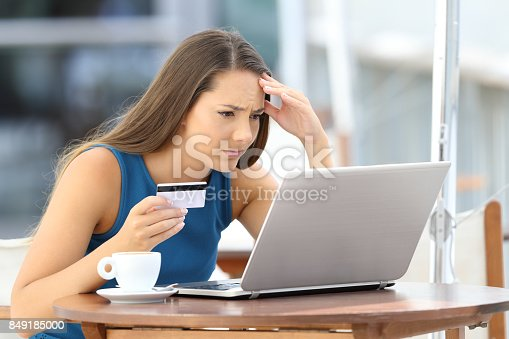 857213750istockphoto Worried shopper paying with credit card 849185000