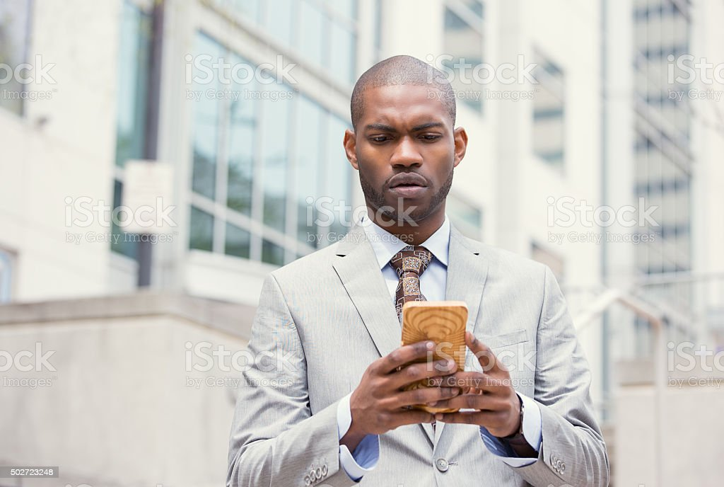 worried unhappy man talking texting on phone displeased - Royalty-free 2015 Stock Photo