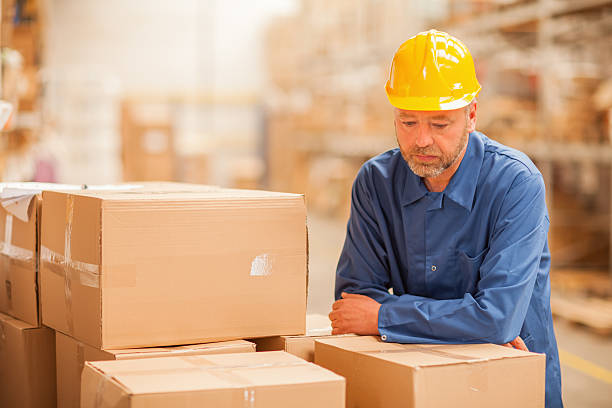 Tire warehouse pictures images and stock photos istock worried warehouse worker stock photo sciox Choice Image