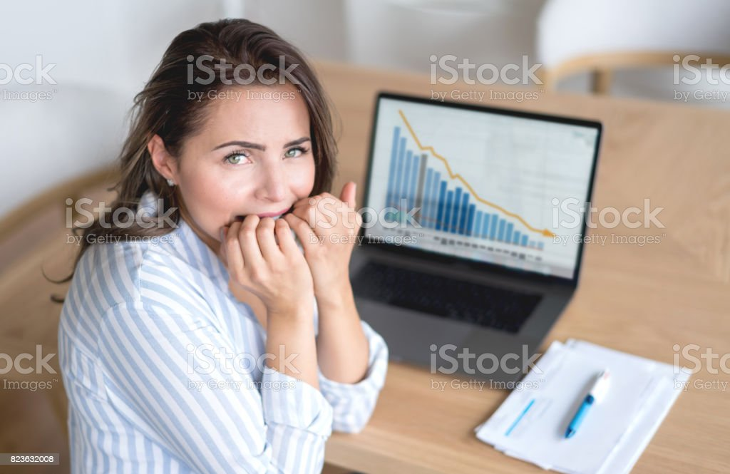 Worried woman at home working online stock photo