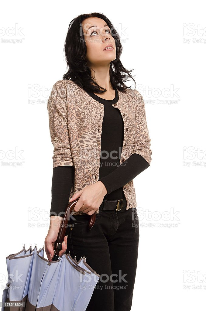 Worried woman checking the sky stock photo