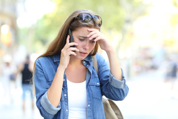 Worried woman having a phone conversation in the street picture id1038960198?b=1&k=6&m=1038960198&s=612x612&w=0&h=m2jxxpchihdkfm5rqcxomdrp76ccsxvdfwbzs2jwazw=
