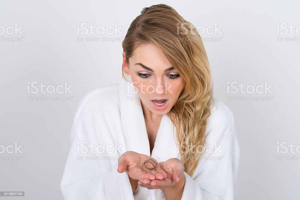 Worried Woman Holding Loss Hair stock photo