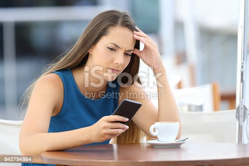 istock Worried woman holding phone and waiting for a call 842794864