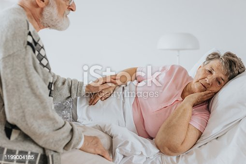 829742744 istock photo Worried woman in bed 1199004185