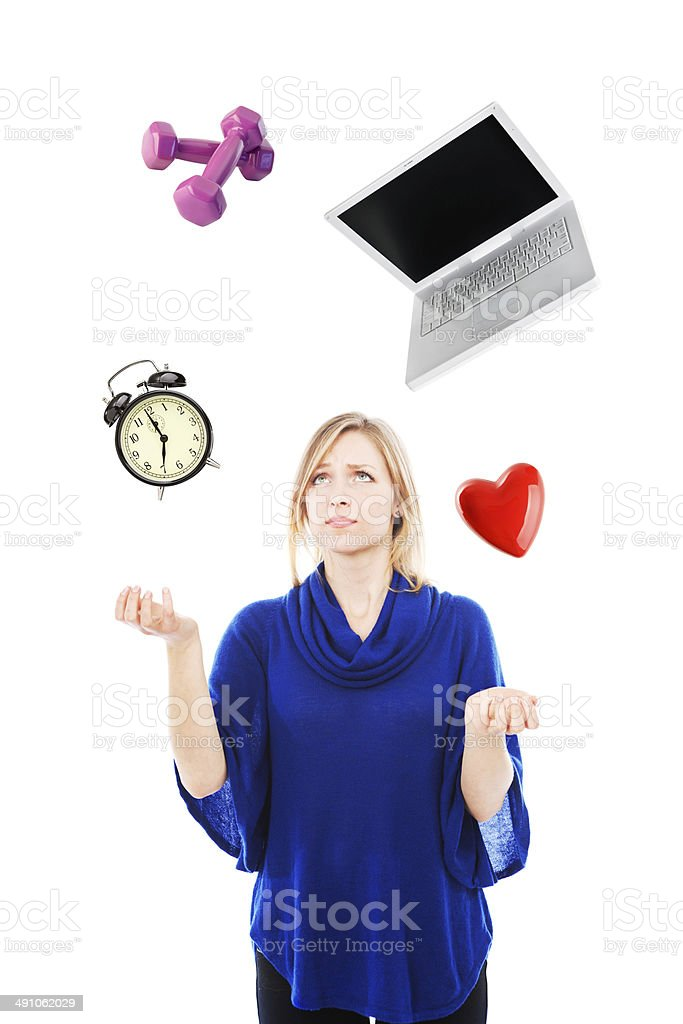 Worried Woman Juggling Work and Home Life stock photo