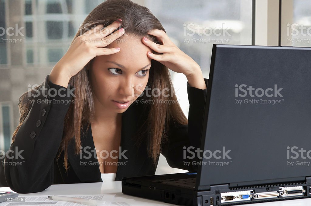 Worried Woman Looking At A Computer Monitor stock photo