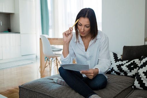 Worried woman reading document